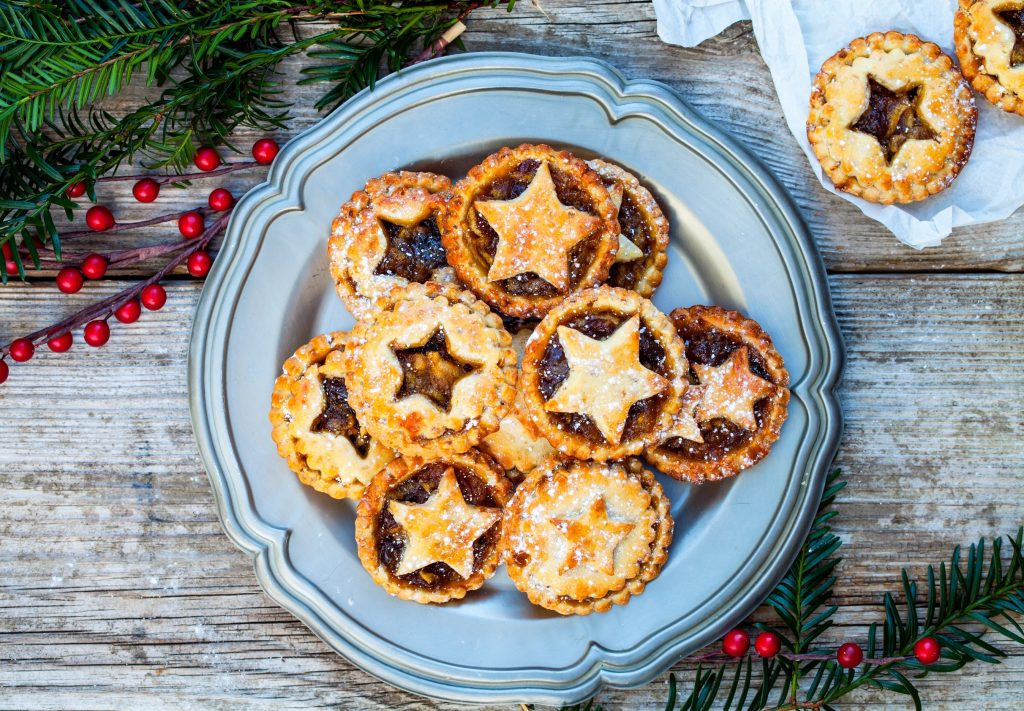 tiny vegan mince pies with stars cut out of them