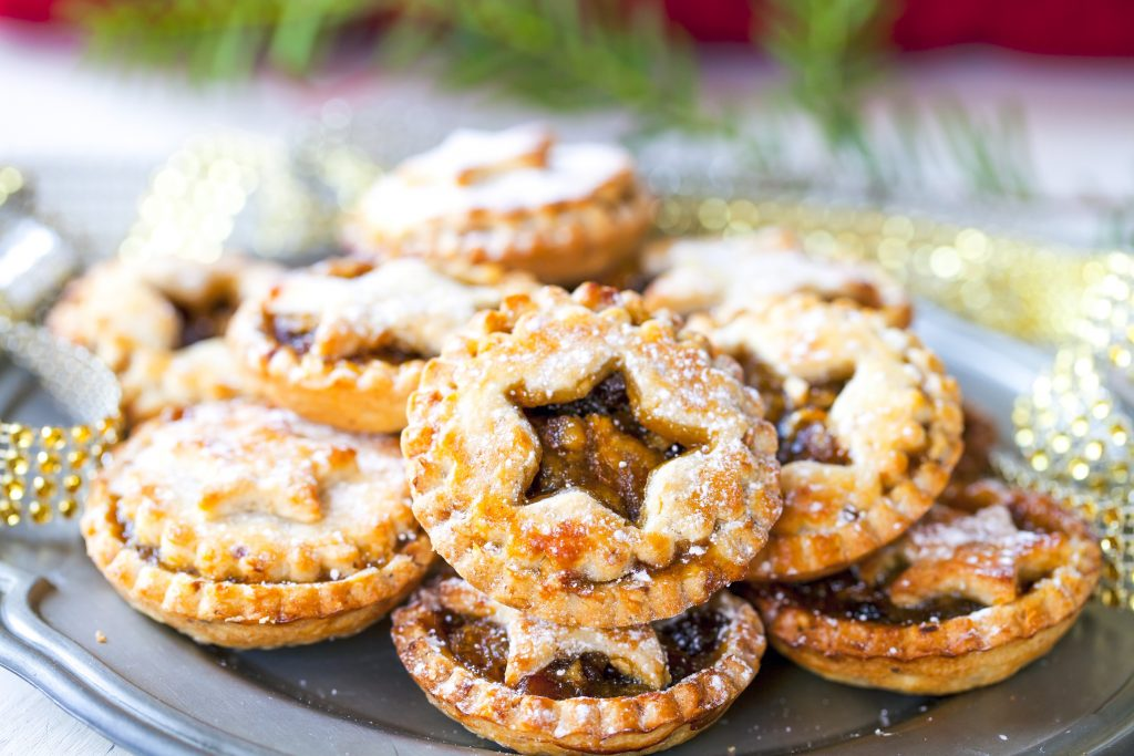 vegan mince pies on a plate with powdered sugar