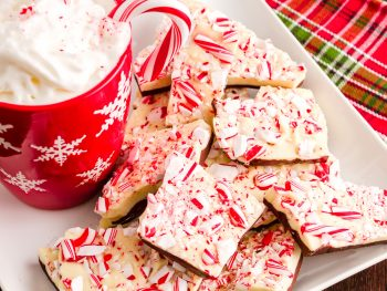 vegan peppermint bark on a plate with a red mug