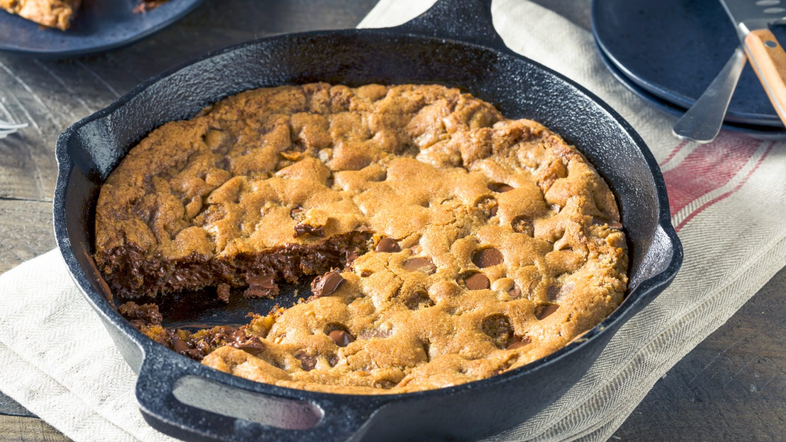 vegan skillet cookie being made in a cast iron pan
