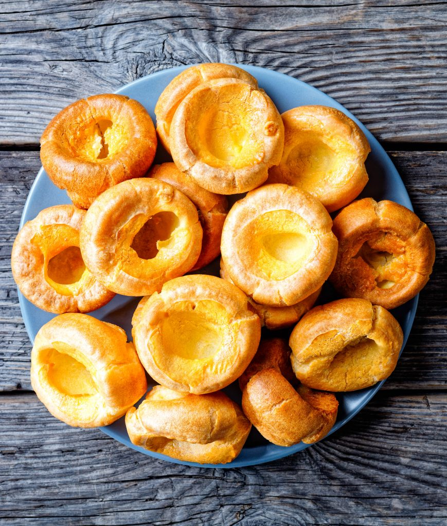 plate filled with vegan yorkshire puddings on a grey background