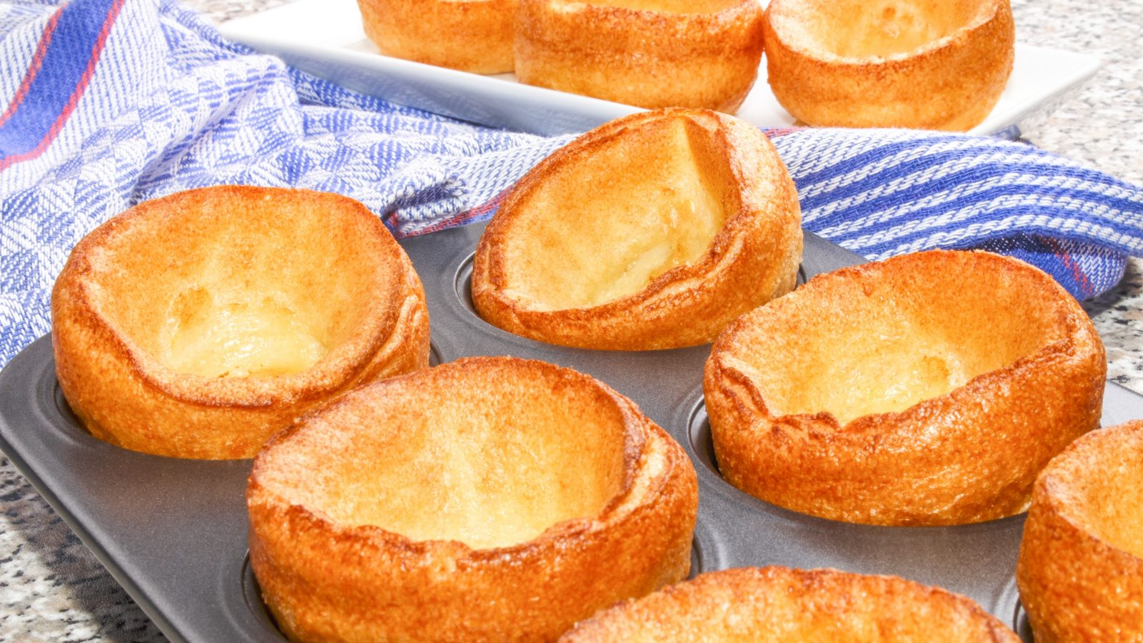 vegan yorkshire puddings in a baking tin