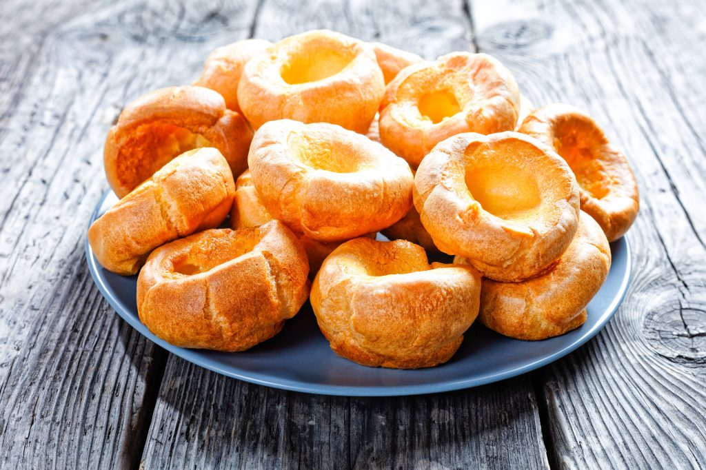 vegan yorkshire puddings stacked on a plate