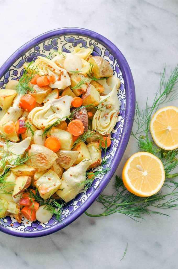 Photo of Artichoke Potato Salad With Dill being served in a blue and white bowl.