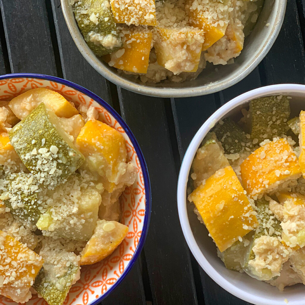 Photo of Lazy Squash & Zucchini Parmesan being served in three bowls.
