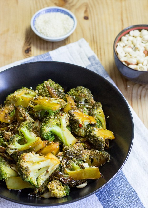 Photo of a bowl serving vegan broccoli salad which is one of the healthiest sides for stuffed peppers.