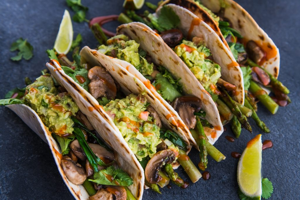 Photo of veggie tacos with lime wedges