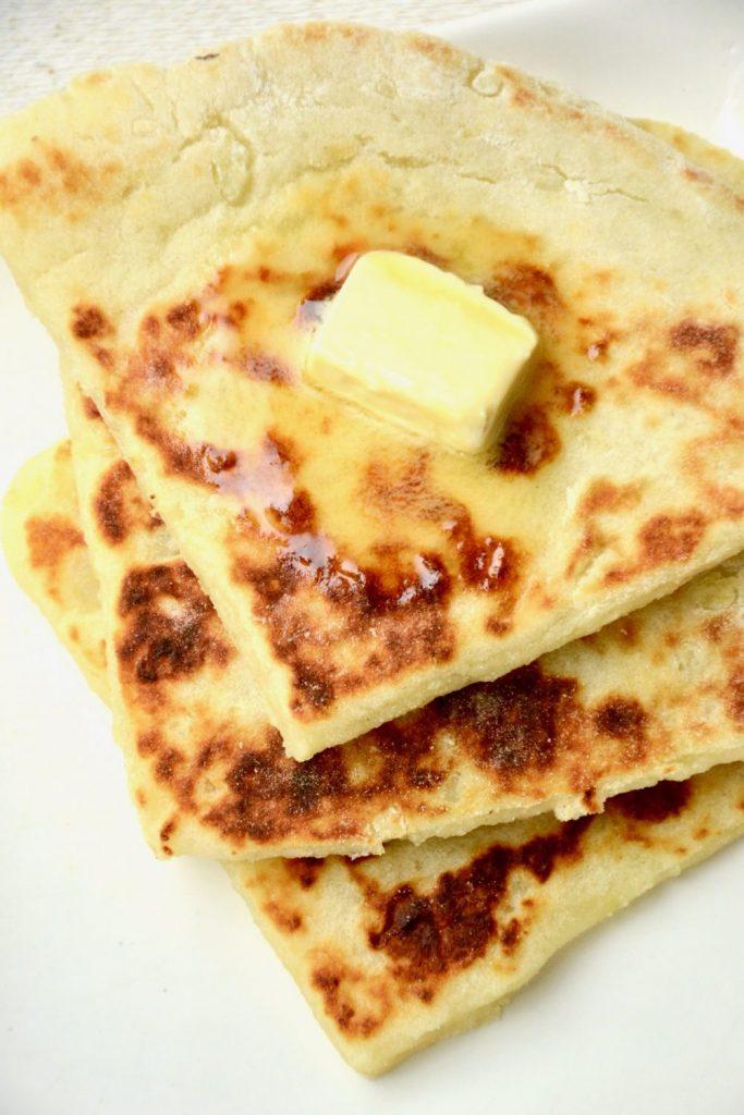Photo of three potato scones with melting vegan butter