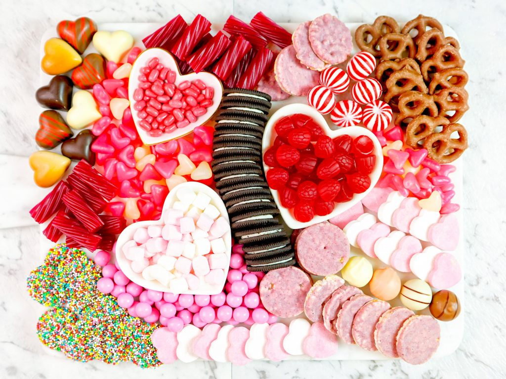 overview of valentines day charcuterie board with cookies and candy