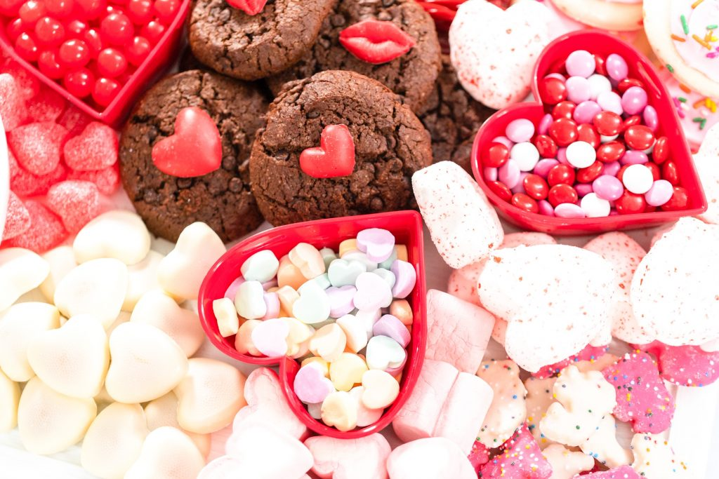 close up of cookies and candies on a dessert board
