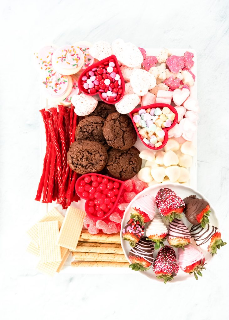 valentines day charcuterie board with cookies, candies, and brownies
