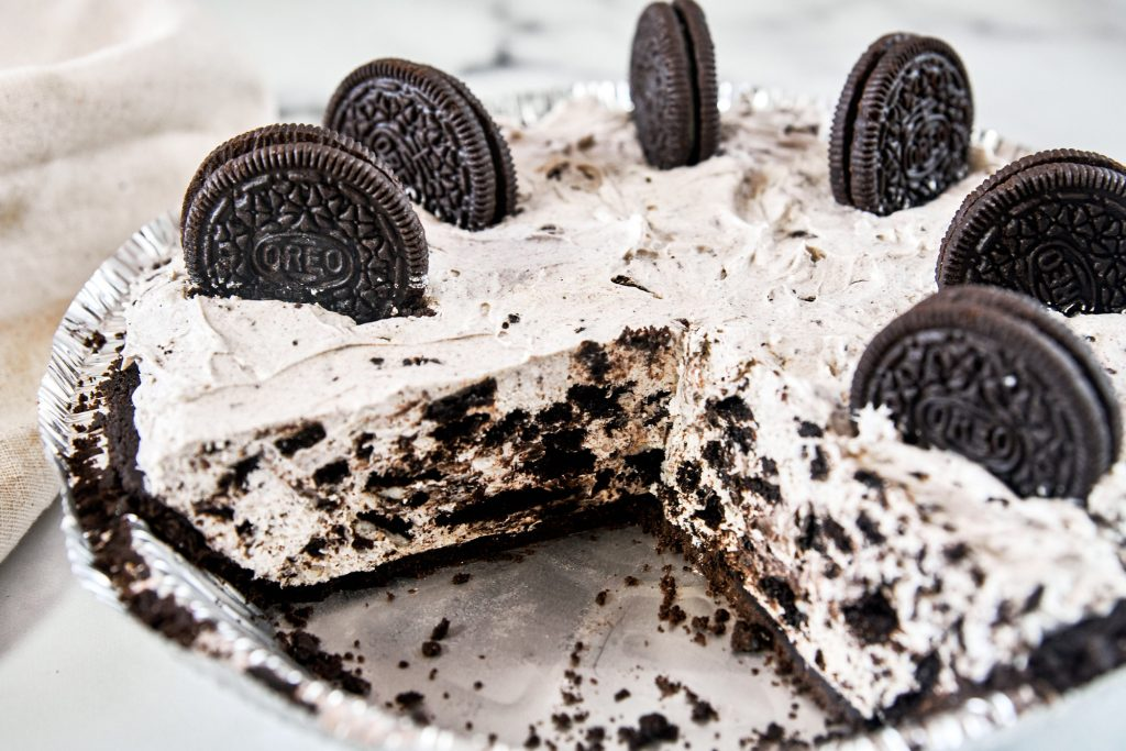 vegan Oreo cheesecake cut into slices so you can see the inside