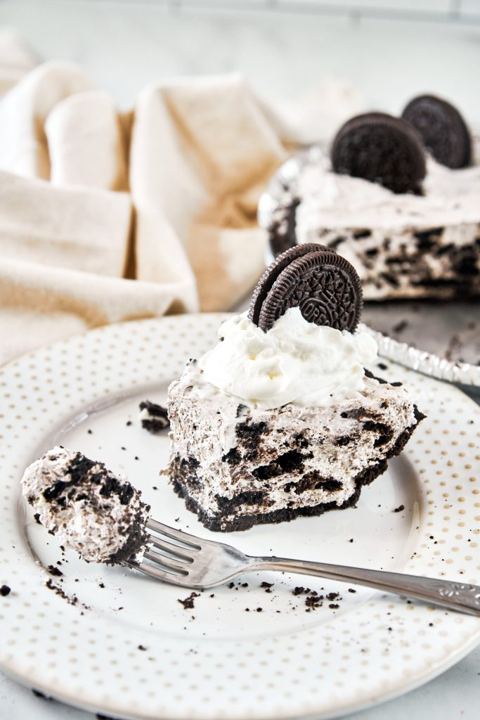 fork taking a piece out of vegan Oreo cheesecake