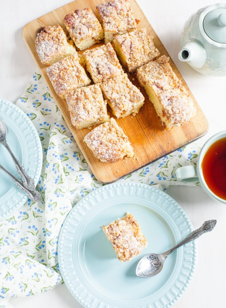 vegan coffee cake cut up on a serving board
