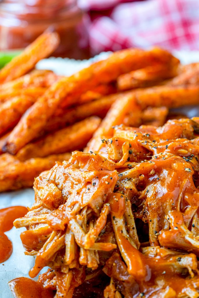 vegan jackfruit pulled pork on a plate with french fries