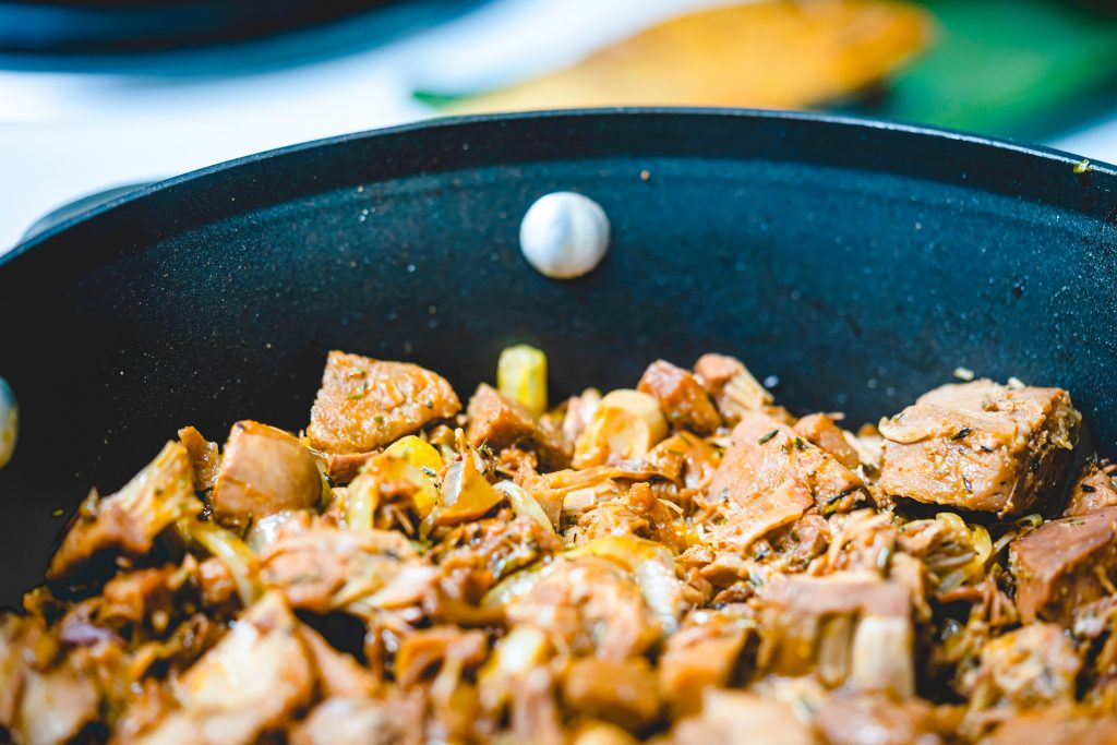 cooking jackfruit in a pan with veggies